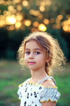 Portrait of smiling beautiful  little girl  of summer park. Happy child looking at the camera