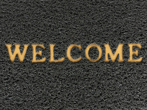 Welcome words on the carpet. Sign and symbol concept. Background and texture of rough nylon mat with welcome alphabet on the surface