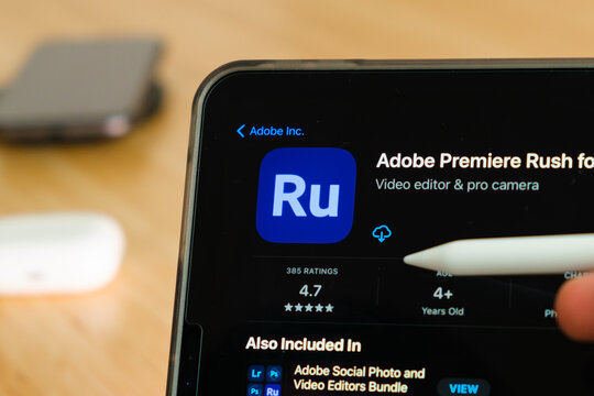 Adobe Premiere Rush logo shown by apple pencil on the iPad Pro tablet screen. Man using application on the tablet. December 2020, San Francisco, USA.