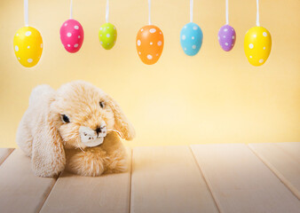 Wooden-based Easter bunny with colorful Easter eggs