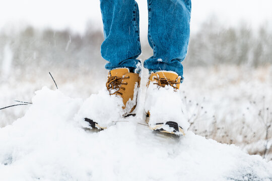 Boy's winter boots closeup on snowy background