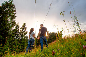Happy young couple enjoy walking forest. Pure nature scenery