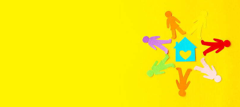 Diversity, inclusion, adoption concept. Colorful paper cut figure on yellow background. Banner