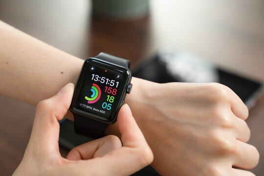 BANGKOK, THAILAND - January 25, 2021 : Woman touching Apple Watch. Digital clock that can be used for many functions.