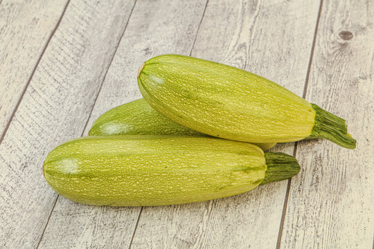 Young tasty zucchini over board