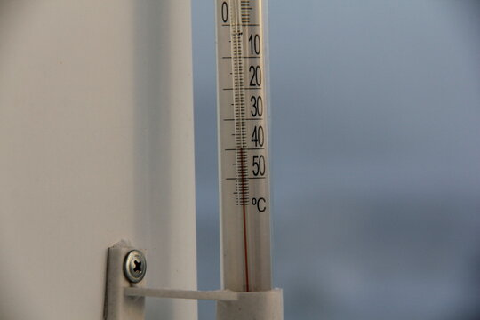 Wall-mounted outdoor thermometer shows - 40 degrees. Severe frost - the thermometer on the window shows - 40 degrees.
