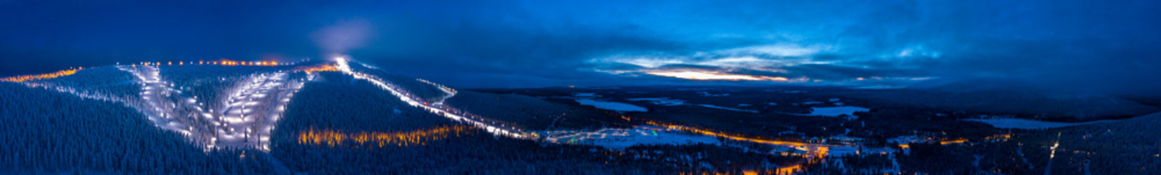 Panoramic cloudy sunset over the ski slopes of Levi, Kittilä, Finland.