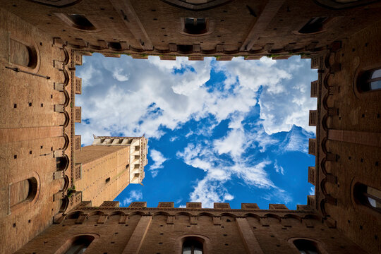 Bottom view of Mangia Tower in Siena