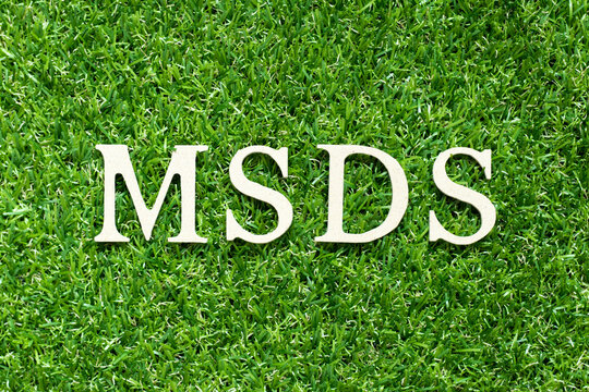 Alphabet letter in word MSDS (Abbreviation of material safety data sheet) on green grass background