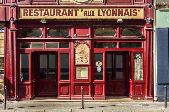 "View ""Aux Lyonnais"" with original sign ""Maison Lyonnaise"": a Parisian bistro dedicated to cuisine of Lyon. This traditional ""Bouchon Lyonnais"" in Paris opened in 1890. PARIS, FRANCE. June 26, 2017."