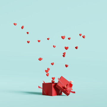 Hearts floating out of red gift box on blue background. Happy Valentines day. 3d rendering