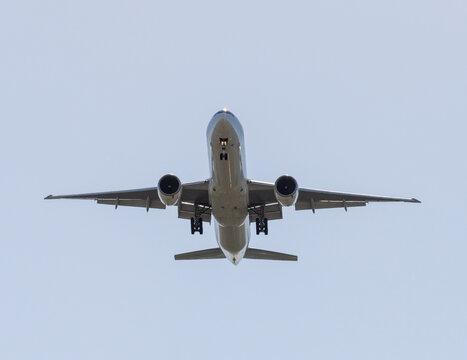 The Gray passenger plane in the sky