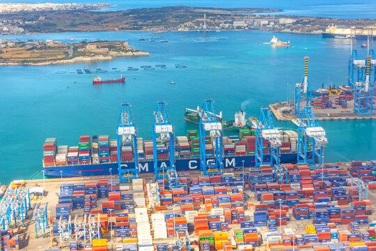 Huge CMA cargo ship for transporting containers in port at unloading. Malta, Il Brolli Marsaxlokk, Malta-Freeport. 14 may 2019.