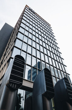 Milan ITALY - July 2018 Modern building glass design, modern office with airway pipes or tube ventilation air.