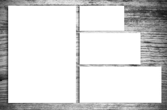 Top view of blank paper on vintage wooden table background.