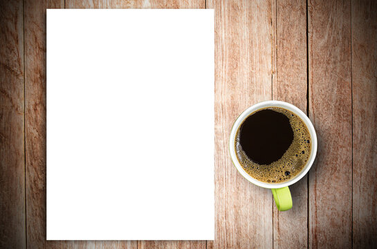 Top view of blank paper and cup of coffee on vintage wooden table background.