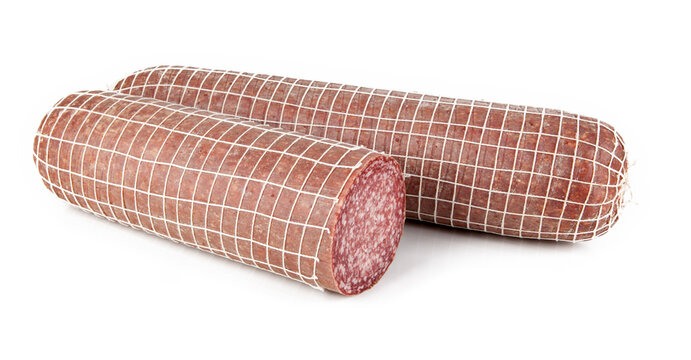 Traditional Italian Milano salami cut in a piece isolated against a white background. View from another angle in the portfolio.