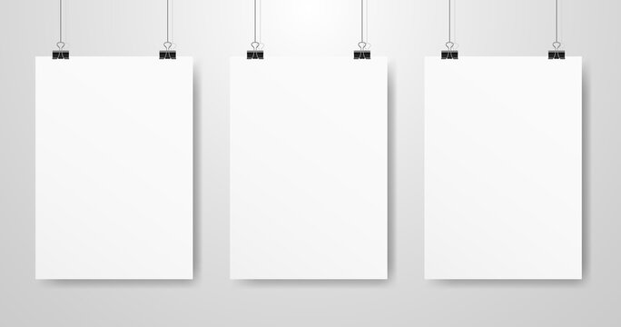 Poster mockups set. White A4 hanging on a light wall. Vertical template with soft shadow. Realistic business template. Clean banner on a rope. Vector illustration