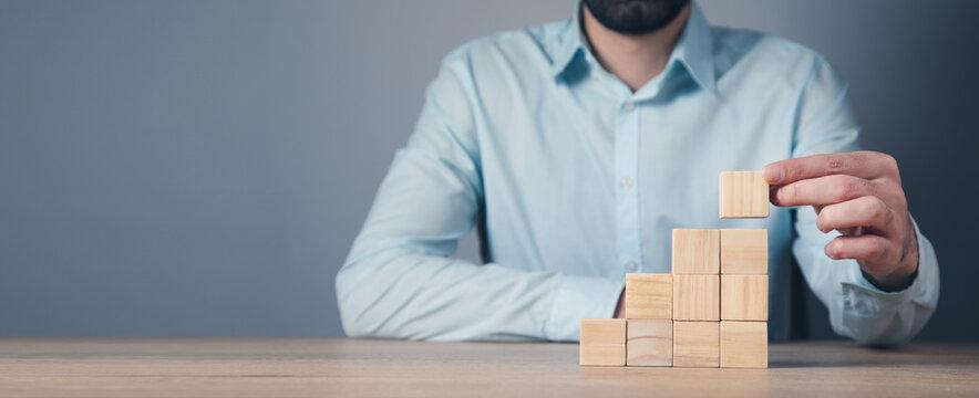Man hand holding wooden blocks
