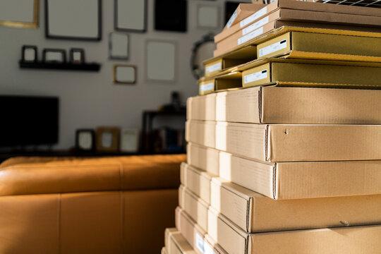 Stack of carton boxes at home