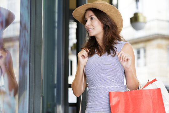 a woman is window shopping