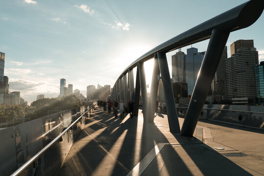 Sunlight shining through architecture with blurred people, Birrarung Marr