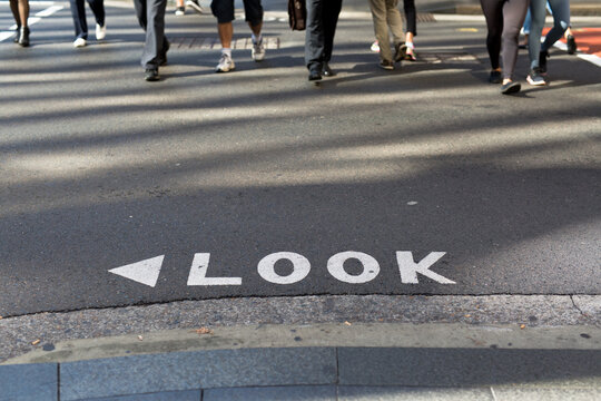 Look sign on a road at a busy intersection in the Sydney CBD