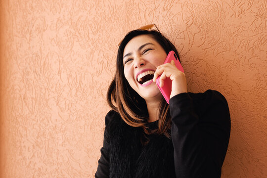 Southeast Asian multicultural woman on the phone