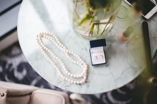 Pearl jewellry on a marble side table
