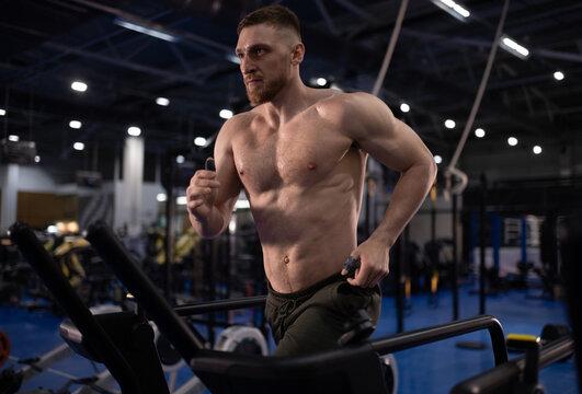 Determined sportsman running on treadmill