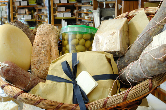 basket with different kinds of salami and cheese from Marche region as ciauscolo, lonza, pecorino and ascolana olives