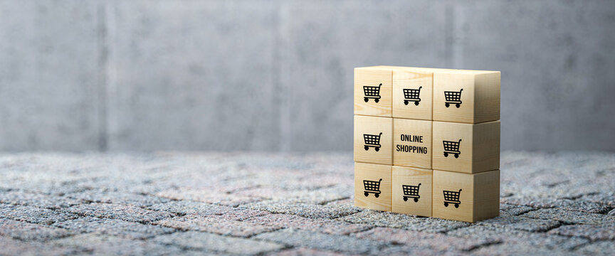 cubes with shopping icons on concrete background