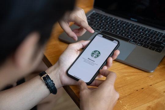 CHIANG MAI, THAILAND - JAN 23, 2021 : Starbucks app on the Apple iPhone display screen. opening online menu page of Starbucks website, Starbucks coffee shop
