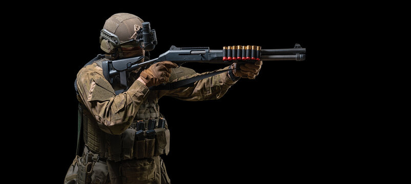 Image of an American soldier taking aim with a shotgun. The concept of military special operations. SWAT group.
