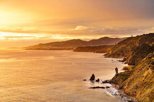 Rocky coast and seaside cliffs at sunset, Spain