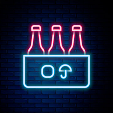 Glowing neon line Pack of beer bottles icon isolated on brick wall background. Case crate beer box sign. Colorful outline concept. Vector.