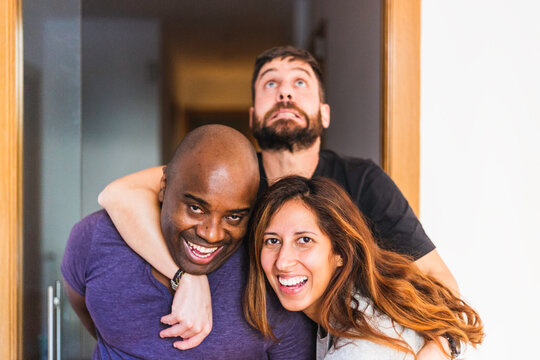 Three interracial friends making silly faces and having fun