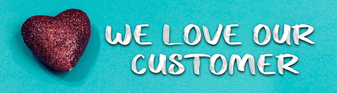 we love our customer concept with heart toy on blue background
