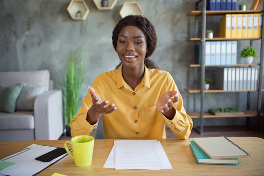 Photo of afro american charming woman speak webcamera new employee human resources indoors in office workplace