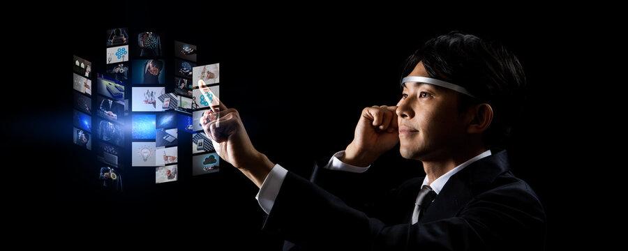 Asian businessmen using AR glasses