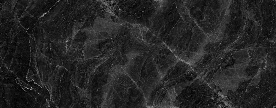 black marble background. black Portoro marble wallpaper and counter tops. black marble floor and wall tile. black travertino marble texture.  natural granite stone.  marbelling