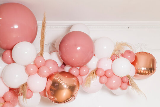 Arch of pink and white balloons; Birthday party decoration for a girl.