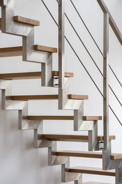 Wooden stairs with silver balustrade