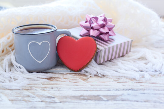 Cookies in shape of heart with cup of coffee or tea on the morning.