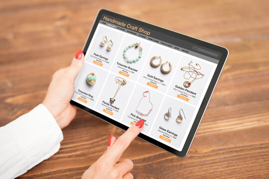 Woman shopping online for custom and hand made jewelry