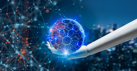 AI,Artificial Intelligence,Big data,iot concept.Robot android hand holding world and network wireless.5G network and internet of things on city background.Elements of this image furnished by NASA.