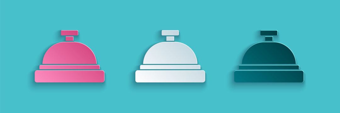 Paper cut Hotel service bell icon isolated on blue background. Reception bell. Paper art style. Vector.