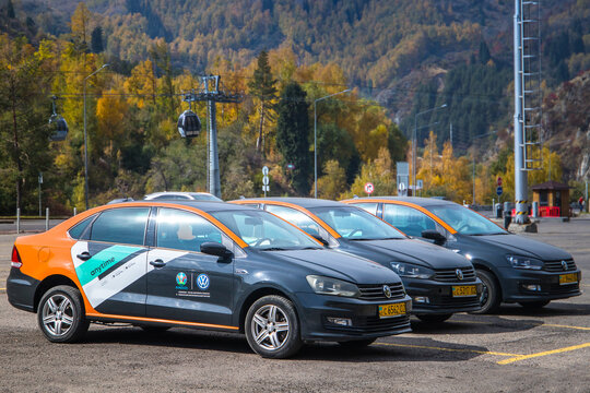 Almaty, Qazaqstan - Oktober, 02, 2020: Car sharing Anytime parked in the the mountains of Almaty region. Carsharing service vehicle