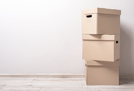 Empty room with cardboard boxes on the floor.