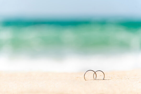 Close-up Of Rings On Sand At Beach